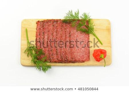 ストックフォト: 唐辛子 · サラミ · スライス · 緑 · 木製 · まな板