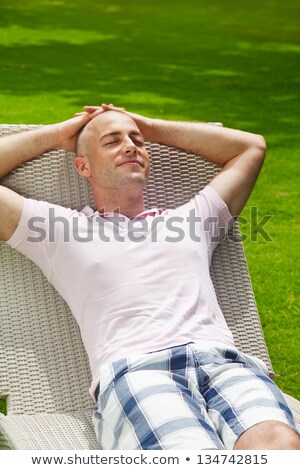 Mature man sitting on deck chair Stock photo © IS2
