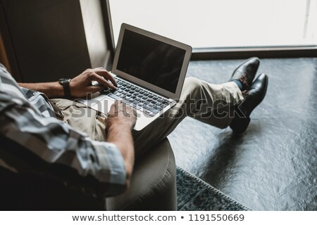 Businessman in armchair on lap-top Stock photo © IS2