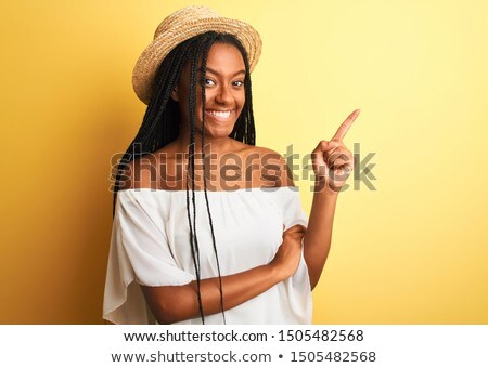 portrait of confident woman in white t-shirt looking to side Stock photo © feedough