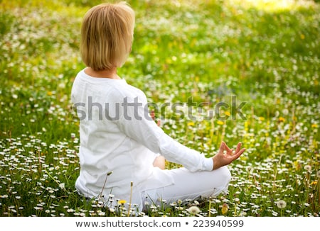Idős nő lótusz pozició fű park Stock fotó © boggy