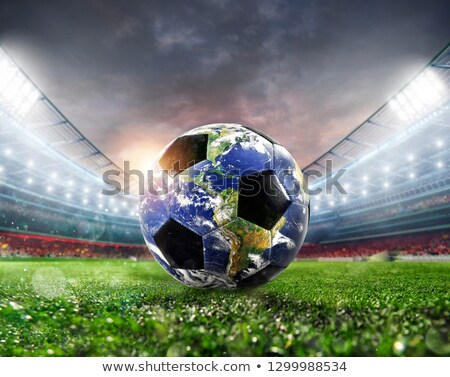 player with a soccer ball a as world earth provided by nasa stock photo © alphaspirit