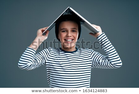 teen boy holding his head and using laptop stock photo © boggy