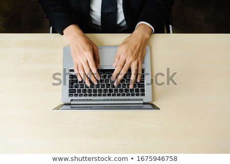Typing in front of monitor stock photo © pressmaster