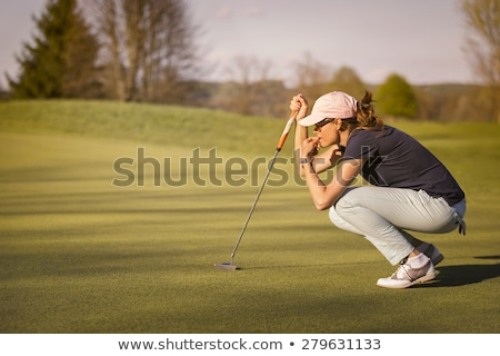 Feminino jogador de golfe pôr do sol mulher golfe clube Foto stock © lichtmeister