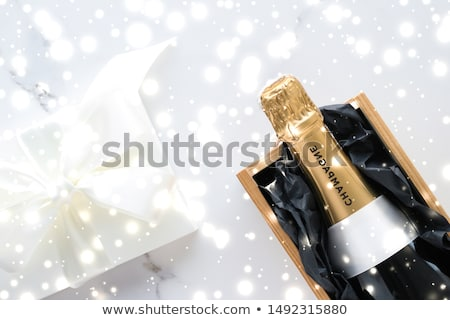 Champagne bottle and gift box on marble, New Years, Christmas, V Stock photo © Anneleven