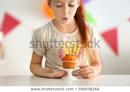 close up of birthday cake with garland on stand Stock photo © dolgachov