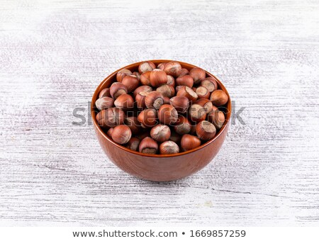whole hazelnut kernels on wooden background Stock photo © mizar_21984