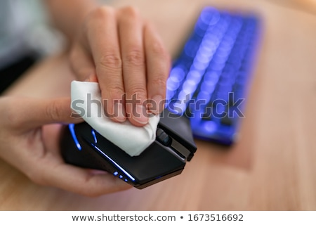 Man Wiping Keyboard With Sanitizer Stock photo © AndreyPopov