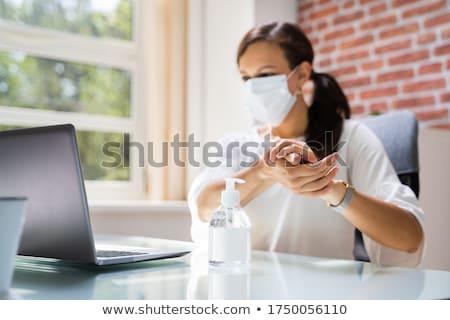 Visage de femme masque alcool hygiène gel femme Photo stock © AndreyPopov