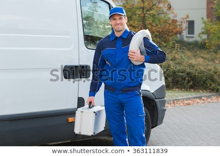 portrait of electrician carrying coil of wire stock photo © photography33