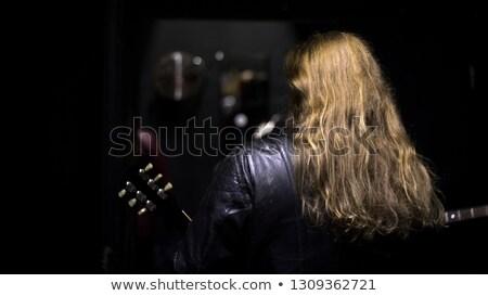 golden guitar girl in fur stock photo © dolgachov