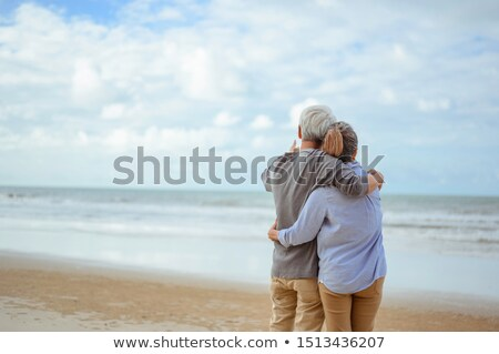 couple holding each other and pointing at the sea stock photo © get4net