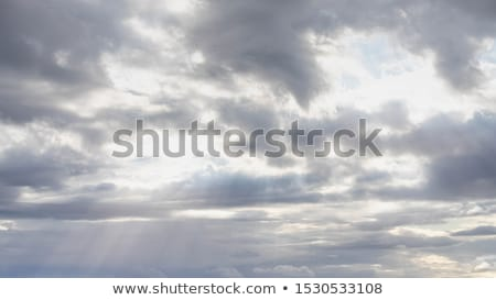 sun shine through rain cloud stock photo © stoonn