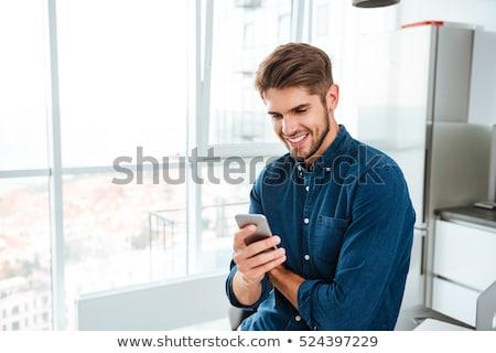 Stok fotoğraf: Genç · telefon · portre · yakışıklı · konuşma