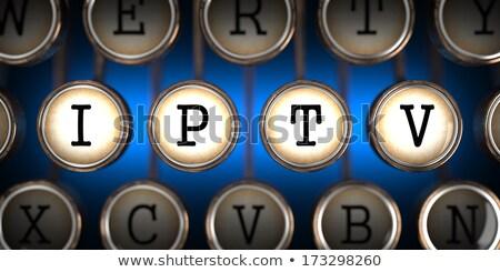 IPTV on Old Typewriter's Keys. Stock photo © tashatuvango