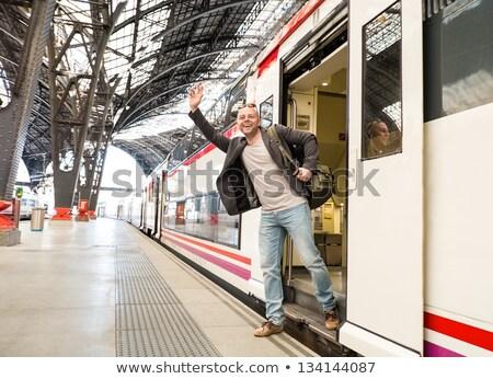 счастливым путешественник заседание кто-то железнодорожная станция Сток-фото © Nejron