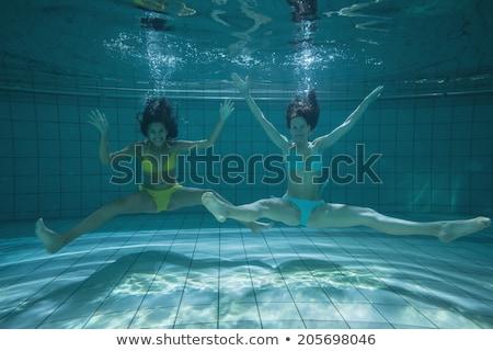 Dość znajomych uśmiechnięty stwarzające kamery podwodne Zdjęcia stock © wavebreak_media