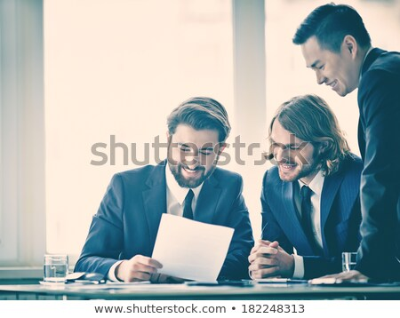Cheerful three young businessmen Stock photo © Paha_L