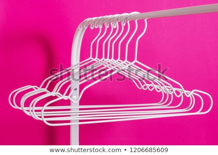 Different clothes on hangers isolated on white background Stock photo © tetkoren