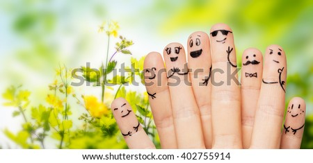 close up of fingers with smiley faces over nature Stock photo © dolgachov