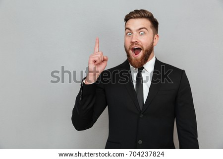Handsome young man yelling with finger up Stock photo © zurijeta