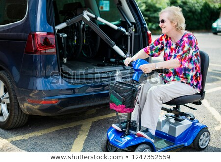 A Caucasian lady riding on a wheelchair Stock photo © bluering