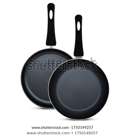 Two frying pans on white background Stock photo © bluering