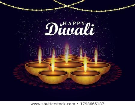 creative golden diwali diya with glowing light effect vector bac Stock photo © SArts