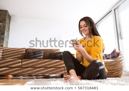 Young woman texting on couch Stock photo © IS2