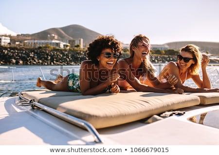 три красивой прыжки бассейна , держась за руки Сток-фото © deandrobot
