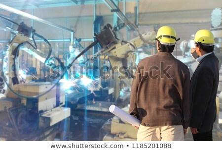 male welds the automotive part in car factory stock photo © kzenon