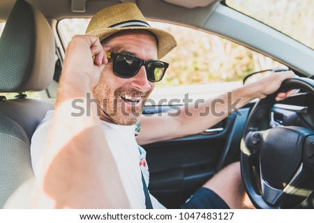 Men sitting in a rental car on holiday vacancy Stock photo © Lopolo