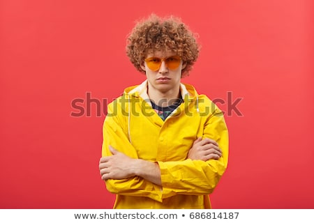 portrait of an angry young man with curly hair stock photo © deandrobot
