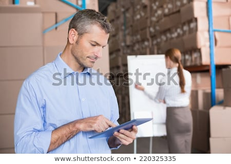 работник бизнесмен склад оптовая торговля деловые люди Сток-фото © dolgachov