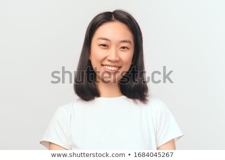 Portrait of a delighted asian woman standing Stock photo © deandrobot