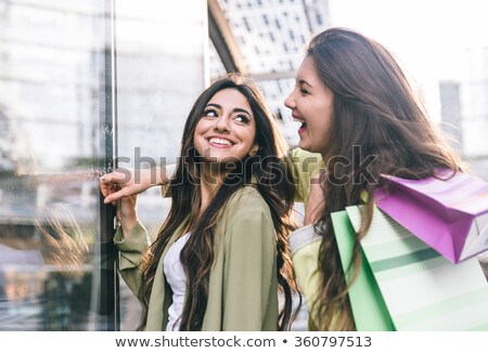 happy fashionable girls having fun togetherspending time at store stock photo © studiolucky