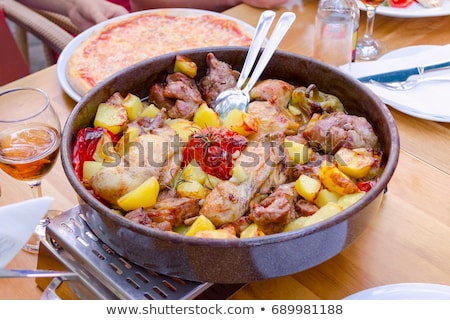 Traditional croatian meat and vegetables dish peka Stock photo © xbrchx