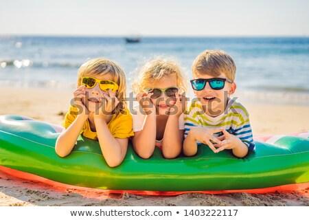 Dzieci siedzieć nadmuchiwane materac okulary morza Zdjęcia stock © galitskaya