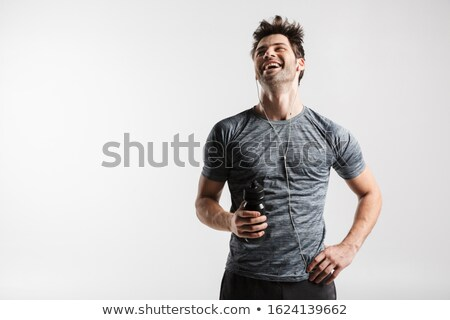 画像 小さな 笑い 男 イヤホン ストックフォト © deandrobot
