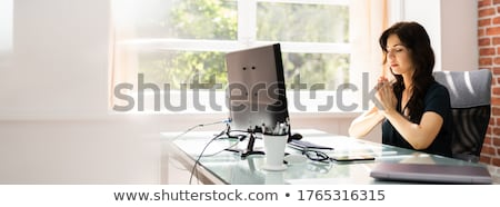 Empregado mulher oração computador escritório trabalhar Foto stock © AndreyPopov