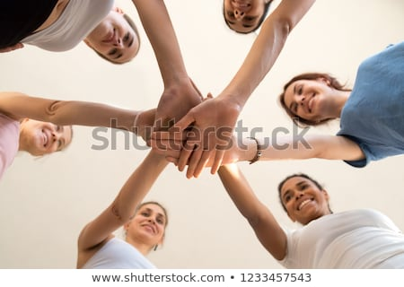 Six friends joining hands low angle view Stock photo © Paha_L