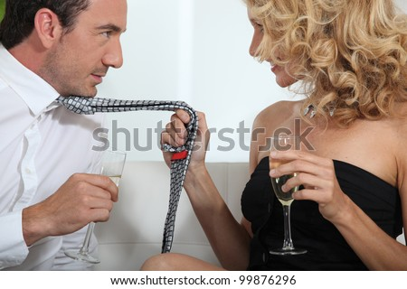Woman grabbing man by tie Stock photo © photography33