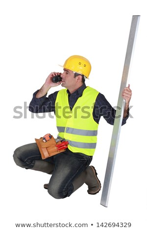 Builder holding a girder while talking on the phone Stock photo © photography33