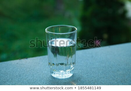 Glass Full of Water against the Green Nature Background Stock photo © maxpro