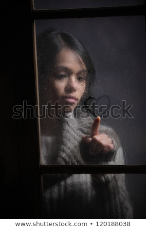 portrait of woman drawing heart on wet window stock photo © stokkete
