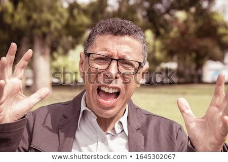 casual man looks frowned at the camera, outdoor Stock photo © feedough