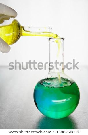 laboratorian reagent drips  Stock photo © OleksandrO