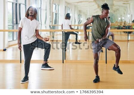 Stock photo: Young man dancing at gym