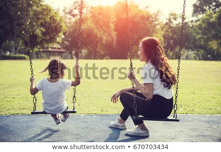 baby female on swing stock photo © adrenalina